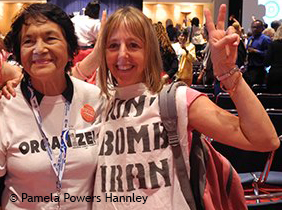 Dolores Huerta and Medea Benjamin at the DNC Women's Caucus meeting, 2012.