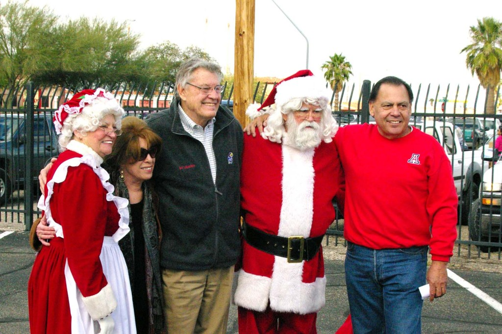 Santa and Mrs. Claus, with John C. Scott and Jesse Lugo (courtesy of Lugo Charities Inc.)