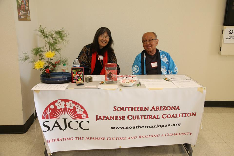 Yours truly at SAJCC table with Director/founder Ross Iwamoto. Note ikebana and hanafuda cards on display. Photo credit James Tokishi
