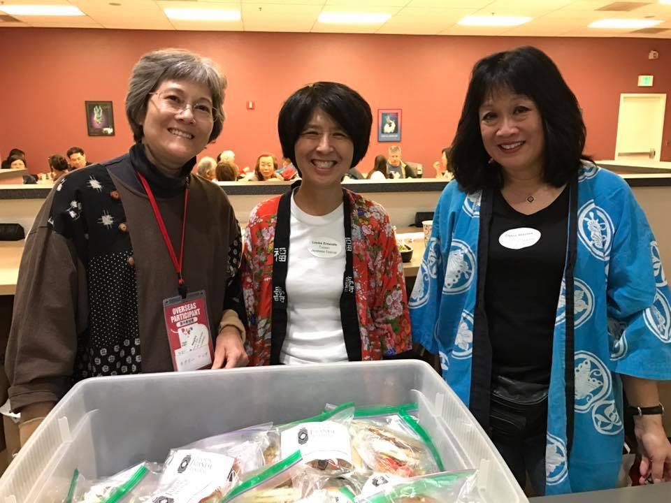 SAJCC Volunteer Coordinator/Secretary K Negley, volunteer Louise Entwhistle, SAJCC graphic designer Crystal Akazawa