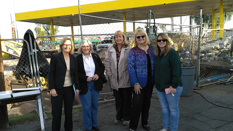 Legislative Reps. Kirsten Engel, Pamela Powers Hannley (far left) and Kelli Townsend (right) with ADEQ staff (center) and Senator Andrea Dalessandro-- watching gas tank removal on a chilly December morning.