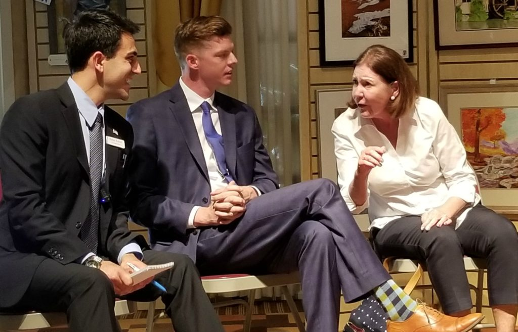 Yahya Yuksel, Billy Kovacs and Ann Kirkpatrick chat at the May 18 candidates forum.