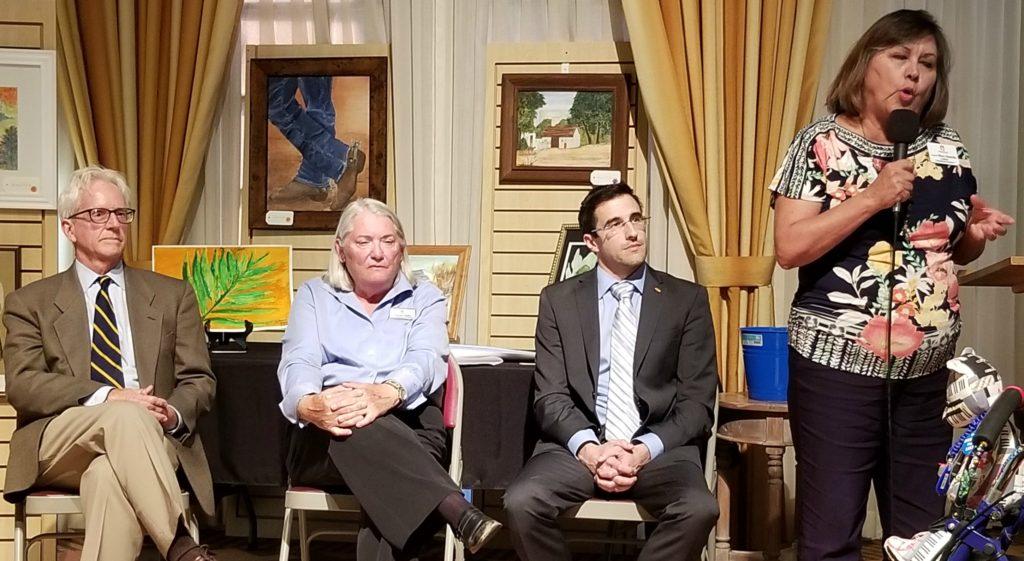 Bruce Wheeler, Barbara Sherry and Matt Heinz listen as Mary Matiella speaks.